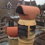 Dangerous Saddle Cowl fitted to live flue